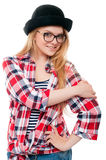 Young teenage girl in black hat, glasses and colorful clothes Royalty Free Stock Photos