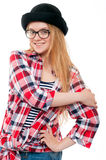 Young teenage girl in black hat, glasses and colorful clothes Stock Photography