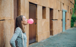 Young Teenage Girl Blowing Pink Bubble Gum Stock Photography