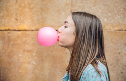 Young teenage girl blowing pink bubble gum Stock Photo