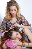 Young teenage girl comforting her friend Royalty Free Stock Images