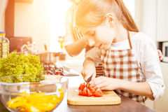 Young teenage girl cook together with her family stock photo