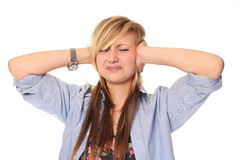 Young teenage girl covering ears Royalty Free Stock Photography