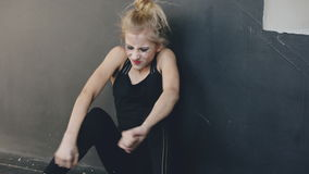 Young teenage girl dancer is very angry and suffering after loss casting sits on floor in dance studio indoors stock footage