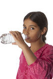 Young teenage girl drinking fresh water from a bottle Stock Image
