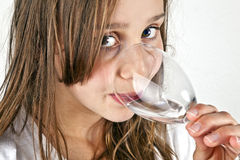 Young teenage girl drinks Stock Photo