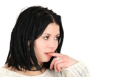 Young teenage girl with finger in mouth Royalty Free Stock Photo