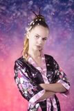 Young teenage girl in floral kimono in studio Royalty Free Stock Image