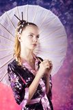 Young teenage girl in floral kimono in studio Stock Photos