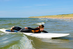 young teenage girl getting surf lessons on vacation. Stock Photography