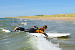 Young teenage girl getting surf lessons on vacation. Stock Photo