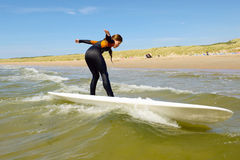 Young teenage girl getting surf lessons on vacation. Royalty Free Stock Photography