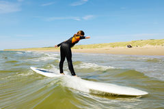 Young teenage girl getting surf lessons on vacation. Royalty Free Stock Images