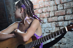 Young teenage girl with guitar Royalty Free Stock Photo