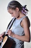 Young teenage girl with guitar Royalty Free Stock Photography