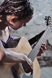 Young teenage girl with guitar Royalty Free Stock Image