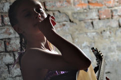 Young teenage girl with guitar Royalty Free Stock Images