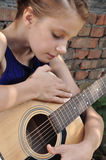 Young teenage girl with guitar Stock Photography