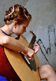 Young teenage girl with guitar Stock Images