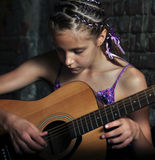 Young teenage girl with guitar Royalty Free Stock Photos