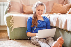 Young teenage girl having fun with laptop at home Stock Image