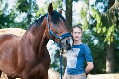 Young teenage girl with her favorite red horse royalty free stock photo