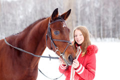 Young teenage girl with her horse in winter park Stock Photos