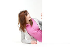 A young teenage girl holding a blank banner Royalty Free Stock Photography