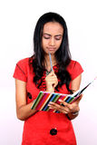 Young teenage girl holding a book. Royalty Free Stock Photography