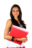 Young teenage girl holding books. Stock Images