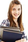 Young teenage girl holding books Stock Image