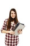 Young teenage girl holding books Stock Photo