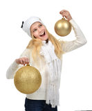 Young teenage girl holding gold christmas balls holiday decorati Stock Photography