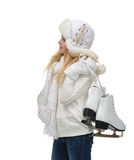 Young teenage girl holding ice skates for winter ice skating spo. Rt activity smiling isolated on a white background Stock Photo