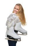 Young teenage girl holding ice skates for winter ice skating sport activity smiling. Isolated on a white background stock image