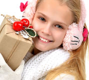 Young teenage girl holding ice skates for winter ice skating spo. Rt activity smiling isolated on a white background Stock Image