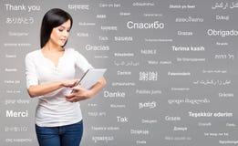 Young teenage girl holding an ipad tablet Stock Image