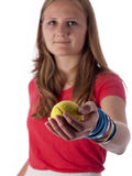 Young teenage girl holding a tennis ball (focus on the ball) Stock Photos