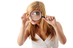 Young teenage girl with magnifier Royalty Free Stock Photos