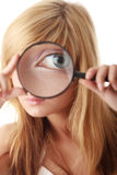 Young teenage girl with magnifier Royalty Free Stock Photo