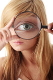 Young teenage girl with magnifier Royalty Free Stock Images