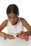 Young teenage girl nail varnishing her nails Royalty Free Stock Photography