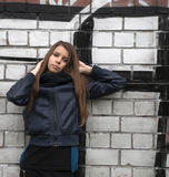 Young teenage girl near a wall Stock Photography