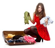 Young teenage girl with an opened suitcase Stock Photos