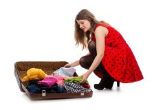 Young teenage girl with an opened suitcase Stock Photography