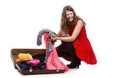 Young teenage girl with an opened suitcase Stock Image