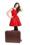 Young teenage girl with an opened suitcase Royalty Free Stock Photography