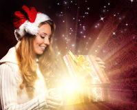 A young teenage girl opening the present Royalty Free Stock Photography