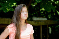 Young teenage girl in the park with  angry facial expression. Stock Images