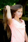 Young teenage girl in the park with  facial expression. Royalty Free Stock Images